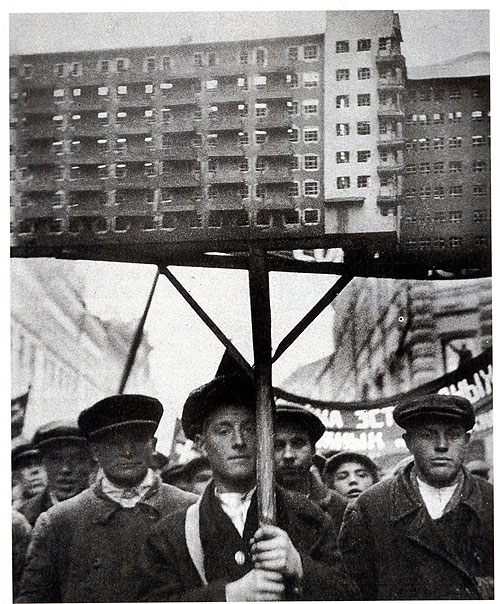 Soviet Workers with a model of planned housing